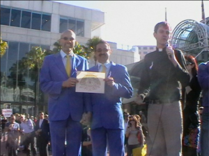 The heat was blazing that day, but 3,000 people showed to march.  The Lord Mayor of Sydney (Clover Moore) addressed the crowd, and then we marched, and when we reached Darling Harbour, Rev. Karl Hand (CRAVE MCC, Sydney) stood up to conduct an illegal wedding.